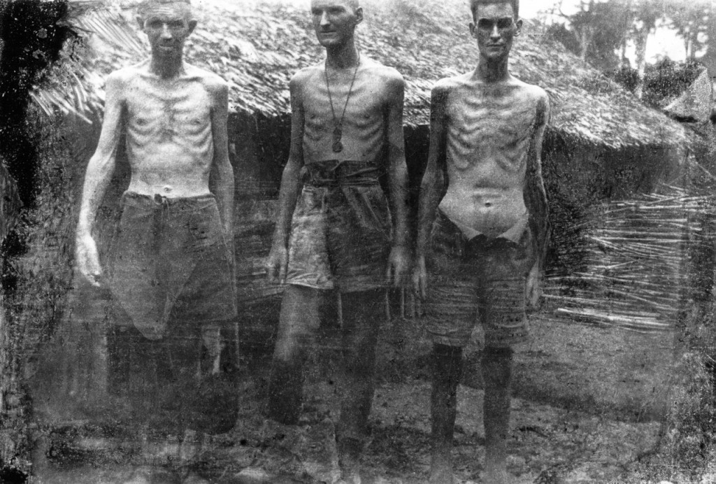 CAPTION: This remarkable photograph taken secretly by Australian Private George Aspinall in northern Thailand during the building of the Thai-Burma Railway shows the skeletal and desperate plight of the so called 'fit' Australian workers the Japanese forced to build the railway in 1943. The swollen stomach of the man on the right is caused by 'wet' beri beri. (Photo from Changi Photographer)