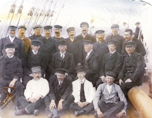 Fram's crew on the deck of Fram in Hobart. Amundsen is sporting the bowler hat