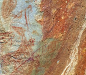 Unfortunately the rock face with the painting was difficult to photograph in full sun, but clearly depicts a marsupial wolf with stripes on its back and a long tail.