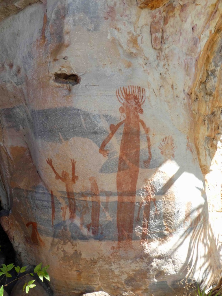 These mysterious figures cannot be categorised and are unlike any other images in the Mt Borradaile area. The sex cannot be determined, and perhaps they are wearing sarongs? The central tallest figure seems rather intimidating, perhaps confirmed by the rather despairing raised arms of the smaller person in the background.